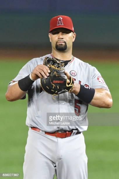 Albert Pujols of the Los Angeles Angels of Anaheim looks on during a baseball game against the Washington Nationals at Nationals Park on August 15...