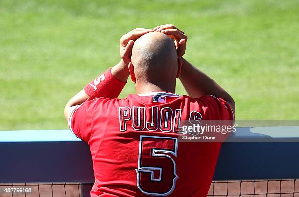 Albert Pujols of the Los Angeles Angels of Anaheim looks on from the dugout during the game with the Los Angeles Dodgers at Dodger Stadium on August...