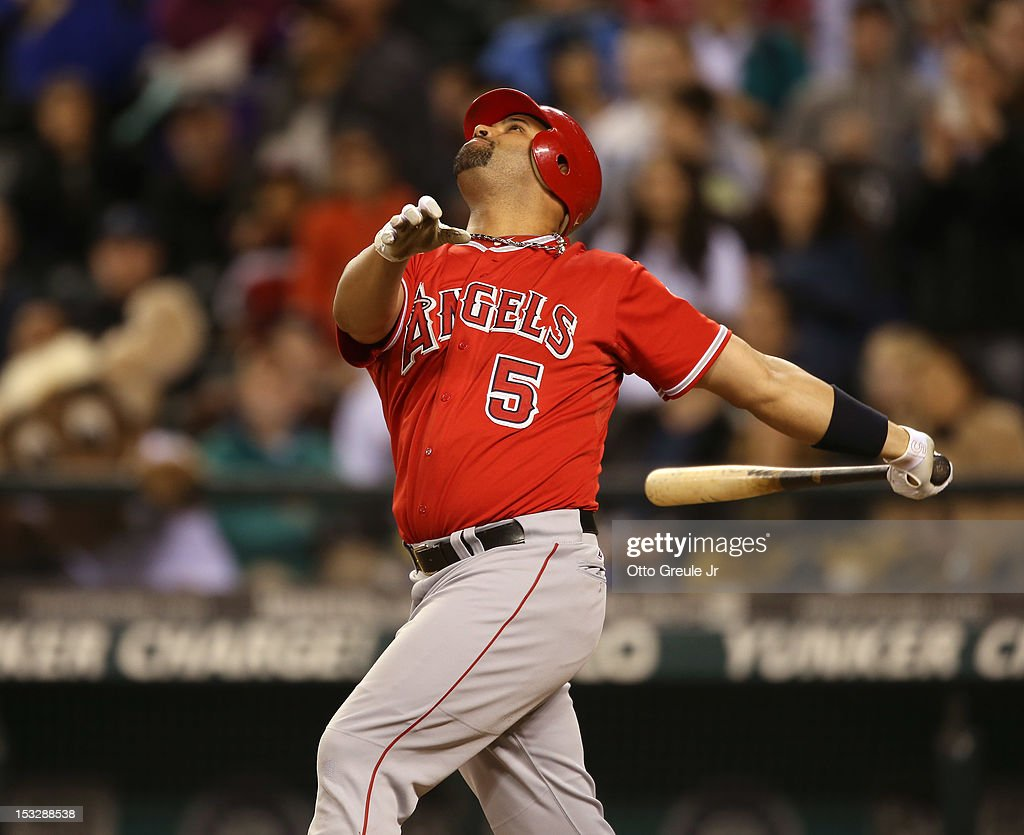Albert Pujols #5 of the Los Angeles Angels of Anaheim makes the final out against the Seattle Mariners at Safeco Field on October 2, 2012 in Seattle, Washington. The Mariners defeated the Angels 6-1.