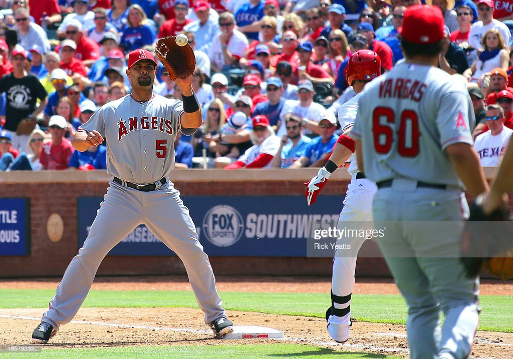 <a gi-track='captionPersonalityLinkClicked' href=/galleries/search?phrase=Albert+Pujols&family=editorial&specificpeople=171151 ng-click='$event.stopPropagation()'>Albert Pujols</a> #5 of the Los Angeles Angels of Anaheim makes the play for the out on <a gi-track='captionPersonalityLinkClicked' href=/galleries/search?phrase=A.J.+Pierzynski&family=editorial&specificpeople=204486 ng-click='$event.stopPropagation()'>A.J. Pierzynski</a> #12 of the Texas Rangers in the eighth inning at Rangers Ballpark on April 5, 2013 in Arlington, Texas.
