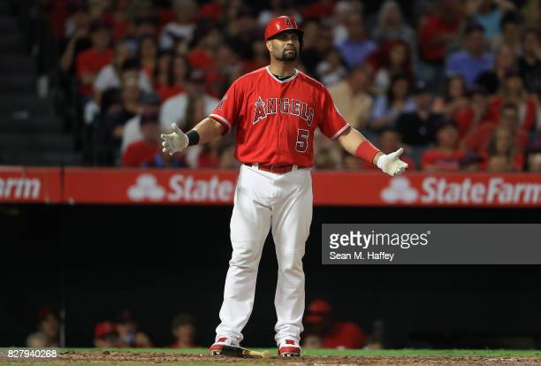 Albert Pujols of the Los Angeles Angels of Anaheim motions to first base umpire Ramon de Jesus after he was called for a third strike during the...