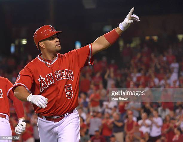Albert Pujols of the Los Angeles Angels of Anaheim points upward while celebrating after hitting a tworun home run during the first inning of the...