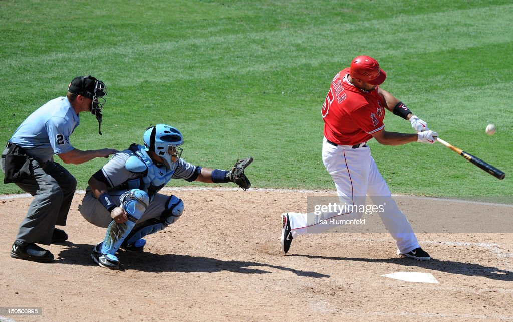<a gi-track='captionPersonalityLinkClicked' href=/galleries/search?phrase=Albert+Pujols&family=editorial&specificpeople=171151 ng-click='$event.stopPropagation()'>Albert Pujols</a> #5 of the Los Angeles Angels of Anaheim pops out in the eighth inning against the Tampa Bay Rays at Angel Stadium of Anaheim on August 19, 2012 in Anaheim, California.