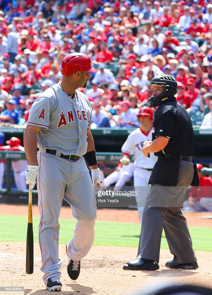 Albert Pujols #5 of the Los Angeles Angels of Anaheim reacts to a called strike by umpire Manny Gonzalez #79 at Rangers Ballpark on April 5, 2013 in Arlington, Texas.