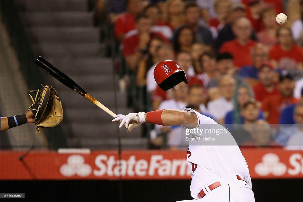 Albert Pujols #5 of the Los Angeles Angels of Anaheim reacts to being hit in the head by a pitch from Tony Barnette #43 of the Texas Rangers during the seventh inning of a baseball game at Angel Stadium of Anaheim on July 19, 2016 in Anaheim, California.
