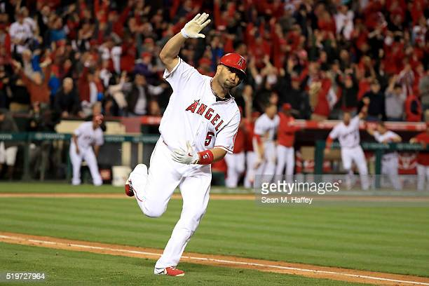 Albert Pujols of the Los Angeles Angels of Anaheim reacts to driving in the winning run with a single during the ninth inning of a baseball game...