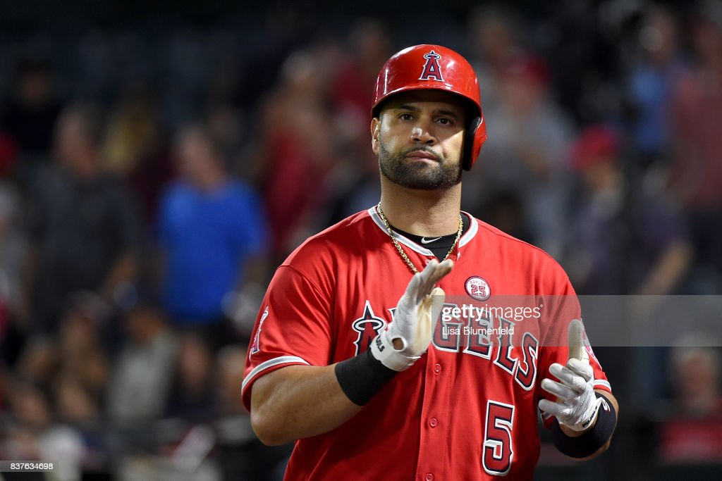 Albert Pujols #5 of the Los Angeles Angels of Anaheim returns to the dugout after hitting a three run homerun in the seventh inning against the Texas Rangers at Angel Stadium of Anaheim on August 22, 2017 in Anaheim, California.