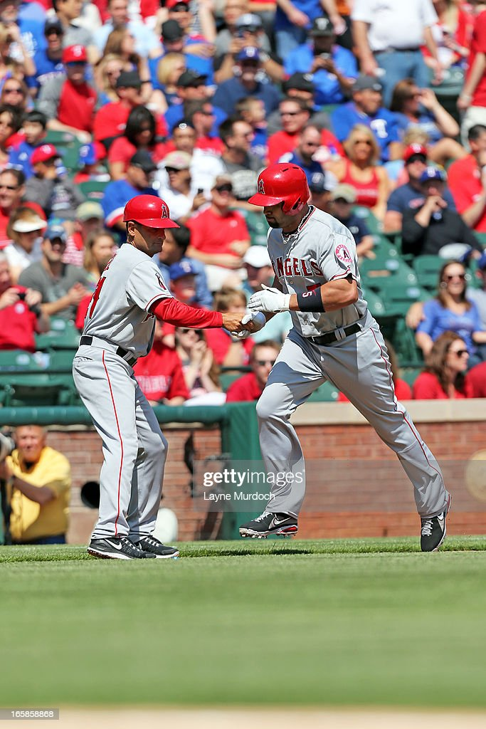 <a gi-track='captionPersonalityLinkClicked' href=/galleries/search?phrase=Albert+Pujols&family=editorial&specificpeople=171151 ng-click='$event.stopPropagation()'>Albert Pujols</a> #5 of the Los Angeles Angels of Anaheim runs the bases after hitting a two-run homer against Matt Harrison #54 of the Texas Rangers on April 6, 2013 at the Rangers Ballpark in Arlington in Arlington, Texas.
