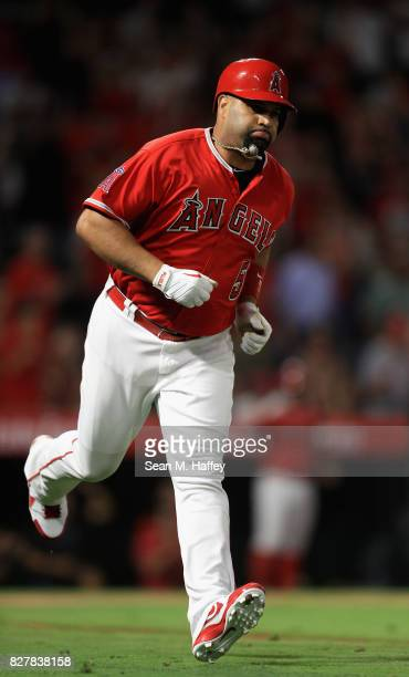 Albert Pujols of the Los Angeles Angels of Anaheim runs to first base during a game against the Philadelphia Phillies at Angel Stadium of Anaheim on...