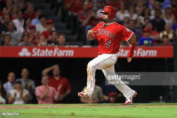 Albert Pujols of the Los Angeles Angels of Anaheim runs to home during a game against the Philadelphia Phillies at Angel Stadium of Anaheim on August...