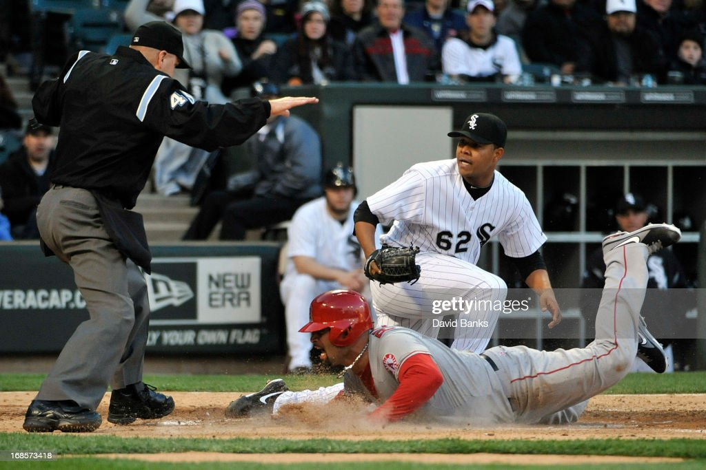 <a gi-track='captionPersonalityLinkClicked' href=/galleries/search?phrase=Albert+Pujols&family=editorial&specificpeople=171151 ng-click='$event.stopPropagation()'>Albert Pujols</a> #5 of the Los Angeles Angels of Anaheim scores on a passed ball as Jose Quintana #62 of the Chicago White Sox makes a late tag during the third inning on May 11, 2013 at U.S. Cellular Field in Chicago, Illinois.