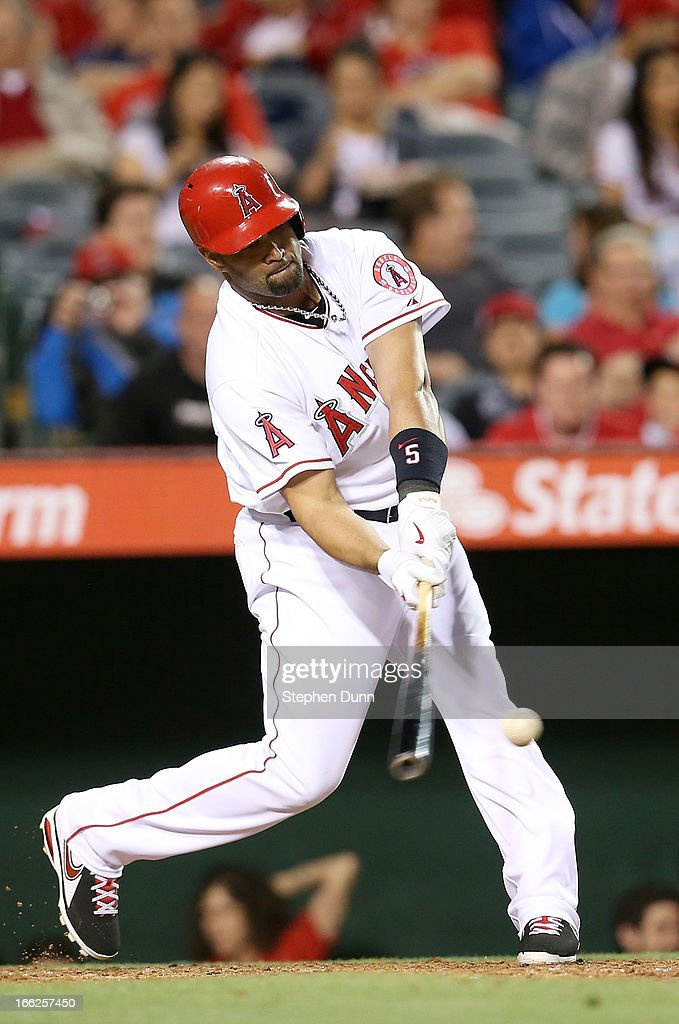 <a gi-track='captionPersonalityLinkClicked' href=/galleries/search?phrase=Albert+Pujols&family=editorial&specificpeople=171151 ng-click='$event.stopPropagation()'>Albert Pujols</a> #5 of the Los Angeles Angels of Anaheim singles in the third inning against the Oakland Athletics at Angel Stadium of Anaheim on April 10, 2013 in Anaheim, California.