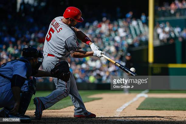 Albert Pujols of the Los Angeles Angels of Anaheim singles in the eighth inning against the Seattle Mariners at Safeco Field on September 4 2016 in...