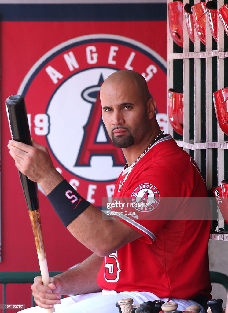 <a gi-track='captionPersonalityLinkClicked' href=/galleries/search?phrase=Albert+Pujols&family=editorial&specificpeople=171151 ng-click='$event.stopPropagation()'>Albert Pujols</a> #5 of the Los Angeles Angels of Anaheim sits in the dugout during the game against the Detroit Tigers at Angel Stadium of Anaheim on April 21, 2013 in Anaheim, California. The Angels won 4-3 in 13 innings.