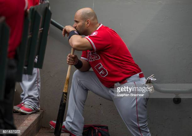 Albert Pujols of the Los Angeles Angels of Anaheim stands in the dugout during a game against the Seattle Mariners at Safeco Field on August 13 2017...