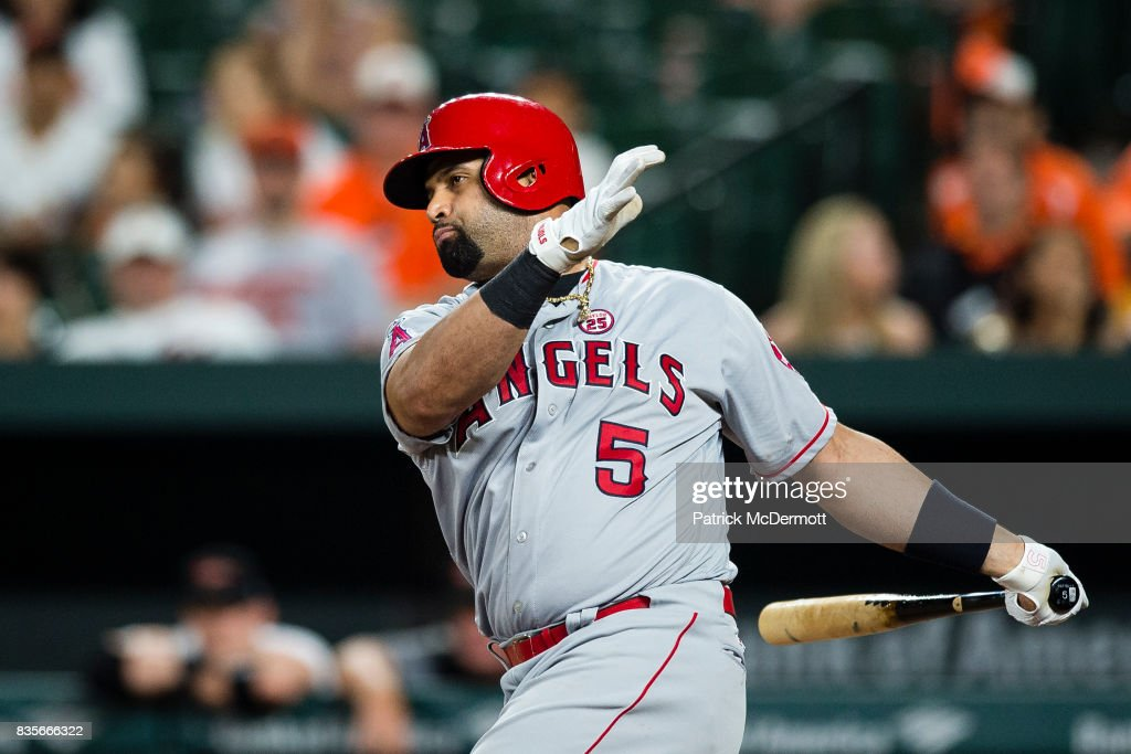 Albert Pujols #5 of the Los Angeles Angels of Anaheim strikes out swinging in the ninth inning during a game against the Baltimore Orioles at Oriole Park at Camden Yards on August 19, 2017 in Baltimore, Maryland.