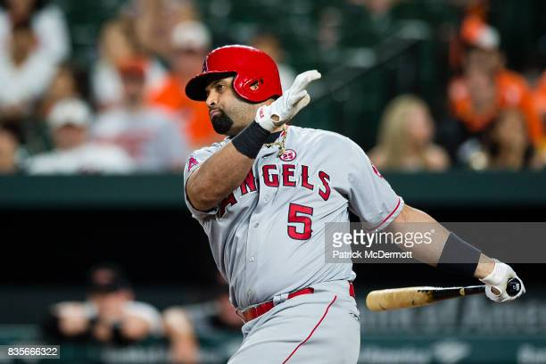 Albert Pujols of the Los Angeles Angels of Anaheim strikes out swinging in the ninth inning during a game against the Baltimore Orioles at Oriole...
