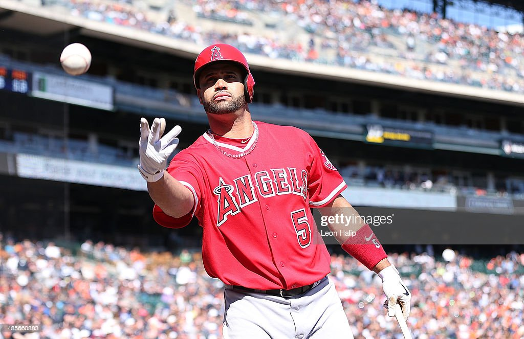 <a gi-track='captionPersonalityLinkClicked' href=/galleries/search?phrase=Albert+Pujols&family=editorial&specificpeople=171151 ng-click='$event.stopPropagation()'>Albert Pujols</a> #5 of the Los Angeles Angels of Anaheim tosses a baseball to a fan during the ninth inning of the game against the Detroit Tigers at Comerica Park on April 19, 2014 in Detroit, Michigan. The Tigers defeated the Angels 5-2.