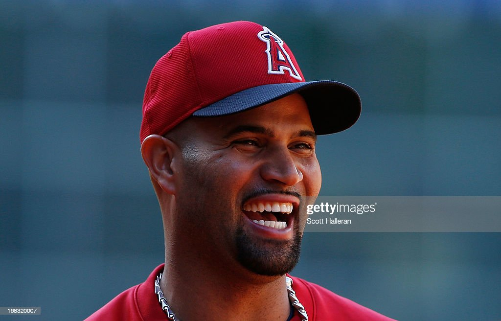 Albert Pujols #5 of the Los Angeles Angels of Anaheim waits near the batting cage before the start of the game against the Houston Astros at Minute Maid Park on May 8, 2013 in Houston, Texas.