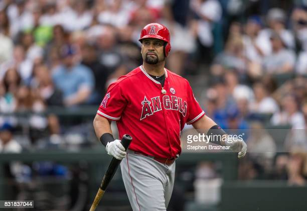 Albert Pujols of the Los Angeles Angels of Anaheim walks off the field after an atbat in a game against the Seattle Mariners at Safeco Field on...
