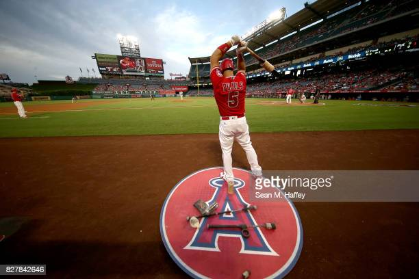 Albert Pujols of the Los Angeles Angels of Anaheim warms up in the on deck circle during a game against the Philadelphia Phillies at Angel Stadium of...