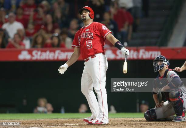 Albert Pujols of the Los Angeles Angels of Anaheim watches as his career home run number 600 clears the wall a grand slam in the fourth inning...