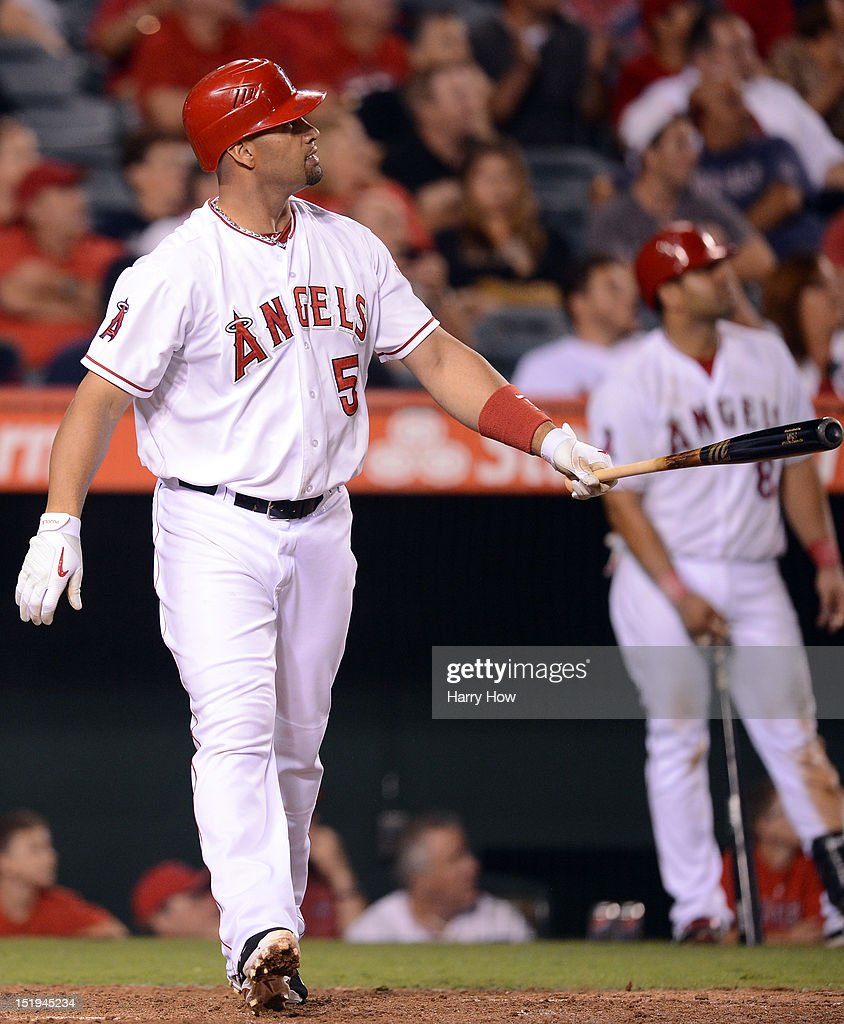 Albert Pujols #5 of the Los Angeles Angels reacts to his homerun to become the first player to hit at least 30 homeruns in each of his first 12 seasons during the ninth inning against the Oakland Athletics at Angel Stadium of Anaheim on September 12, 2012 in Anaheim, California.