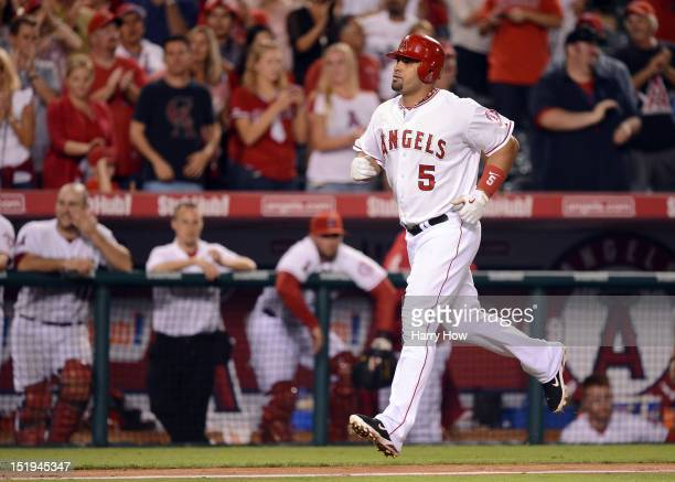 Albert Pujols of the Los Angeles Angels runs the bases after his homerun to become the first player to hit at least 30 homeruns in each of his first...