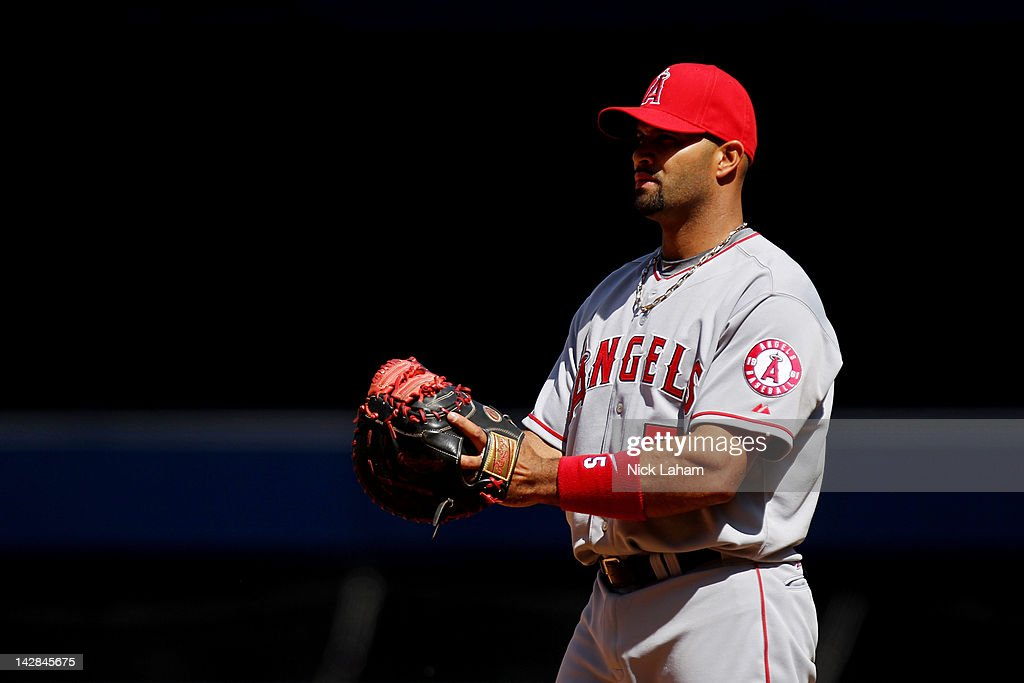<a gi-track='captionPersonalityLinkClicked' href=/galleries/search?phrase=Albert+Pujols&family=editorial&specificpeople=171151 ng-click='$event.stopPropagation()'>Albert Pujols</a> #5 of the Los Angeles Angels stands in the field against the New York Yankees during the home opener at Yankee Stadium on April 13, 2012 in the Bronx borough of New York City.