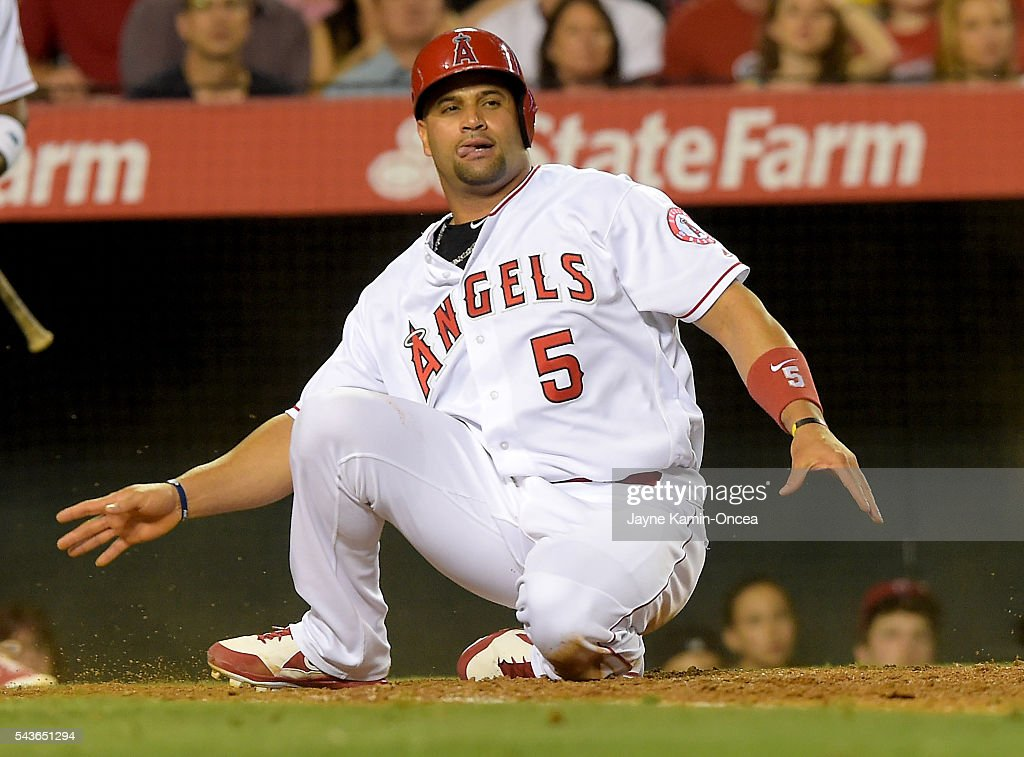 <a gi-track='captionPersonalityLinkClicked' href=/galleries/search?phrase=Albert+Pujols&family=editorial&specificpeople=171151 ng-click='$event.stopPropagation()'>Albert Pujols</a> #5 of the Los Angeles Angels tries to stand up after he was tagged out at home by Jason Castro #15 of the Houston Astros in the seventh inning of the game at Angel Stadium of Anaheim on June 27, 2016 in Anaheim, California.