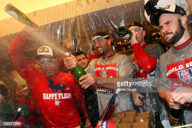 Albert Pujols of the St Louis Cardinals celebrates in the locker room after defeating the Texas Rangers 62 to win Game Seven of the MLB World Series...