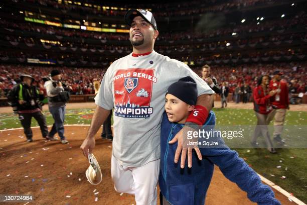 Albert Pujols of the St Louis Cardinals celebrates with family after defeating the Texas Rangers 62 to win the World Series in Game Seven of the MLB...