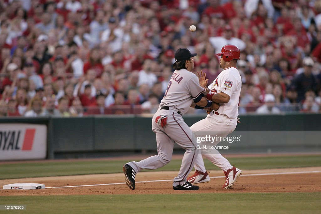 Albert Pujols of the St Louis Cardinals collides with Vinny Castilla of the Washington Nationals at Busch Stadium in St Louis Mo on May 28 2005 St...