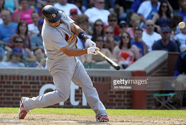 Albert Pujols of the St Louis Cardinals connects on a ninth inning home run against the Chicago Cubs on May 30 2010 at Wrigley Field in Chicago...