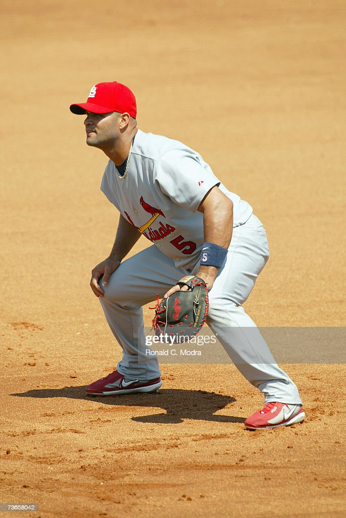Albert Pujols of the St Louis Cardinals fielding in a game against the Minnesota Twins on March 13 2007 in Ft Meyers Florida