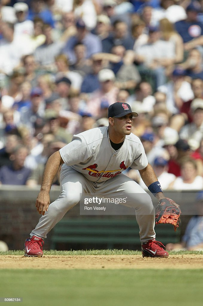 Albert Pujols of the St Louis Cardinals gets ready at first base during the game against the Chicago Cubs at Wrigley Field on May 21 2004 in Chicago...