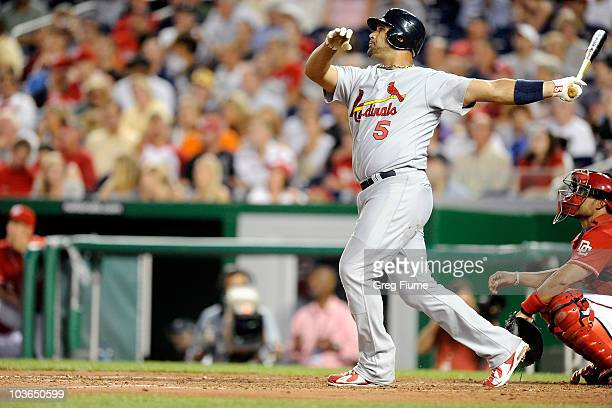 Albert Pujols of the St Louis Cardinals hits a home run in the fourth inning against the Washington Nationals at Nationals Park on August 26 2010 in...