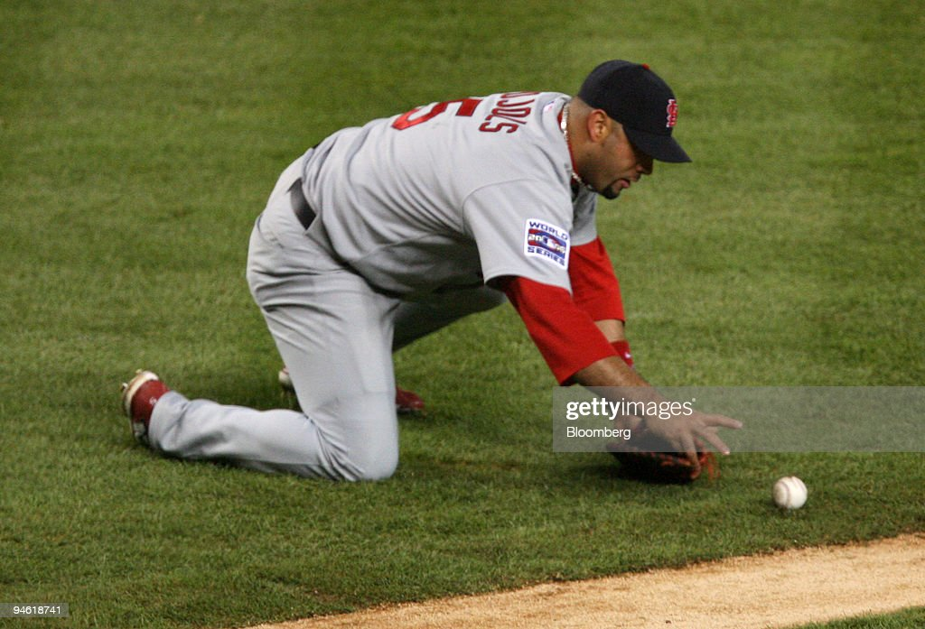 Albert Pujols of the St Louis Cardinals misplays a bunt during the fourth inning of Game 2 of the World Series against the Detroit Tigers in Detroit...