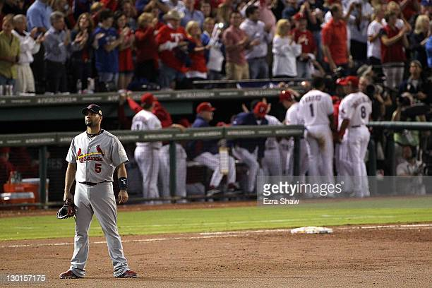 Albert Pujols of the St Louis Cardinals reacts after a threerun home run by Mike Napoli of the Texas Rangers in the sixth inning during Game Four of...