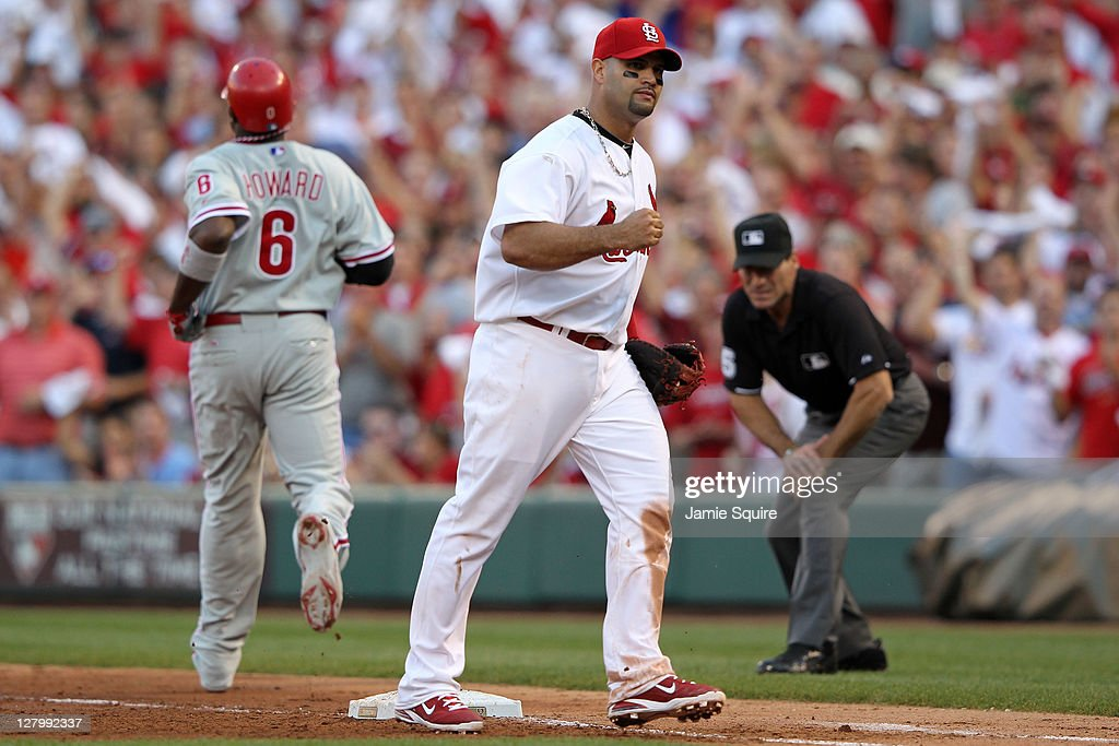 <a gi-track='captionPersonalityLinkClicked' href=/galleries/search?phrase=Albert+Pujols&family=editorial&specificpeople=171151 ng-click='$event.stopPropagation()'>Albert Pujols</a> #5 of the St. Louis Cardinals reacts after the final out of the sixth inning on a ground out by <a gi-track='captionPersonalityLinkClicked' href=/galleries/search?phrase=Ryan+Howard&family=editorial&specificpeople=551402 ng-click='$event.stopPropagation()'>Ryan Howard</a> #6 of the Philadelphia Phillies during Game Three of the National League Division Series at Busch Stadium on October 4, 2011 in St Louis, Missouri.