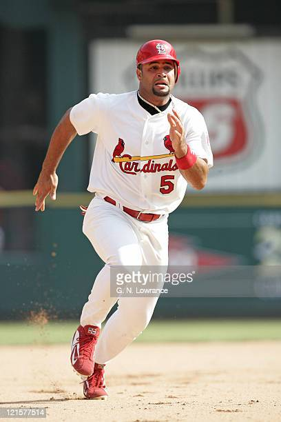 Albert Pujols of the St Louis Cardinals runs to third base during a game against the Chicago Cubs at Busch Stadium in St Louis Mo on July 23 2005 The...