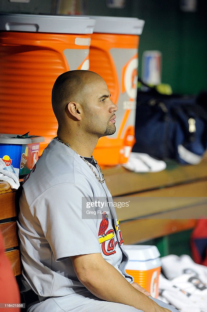 Albert Pujols #5 of the St. Louis Cardinals sits in the dugout after leaving the game in the eighth inning against the Washington Nationals at Nationals Park on June 15, 2011 in Washington, DC. The Nationals won the game 10-0.
