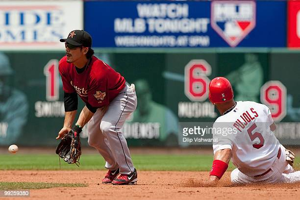 Albert Pujols of the St Louis Cardinals steals second base on wild pitch against Kazuo Matsui of the Houston Astros at Busch Stadium on May 13 2010...