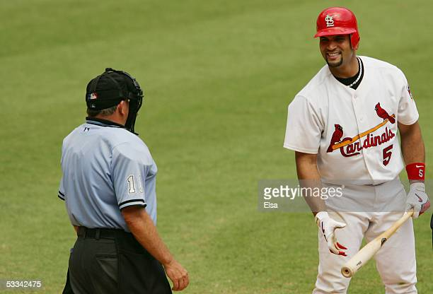 Albert Pujols of the St Louis Cardinals talks with umpire Ed Montague during the MLB game against the Milwaukee Brewers on July 21 2005 at Busch...