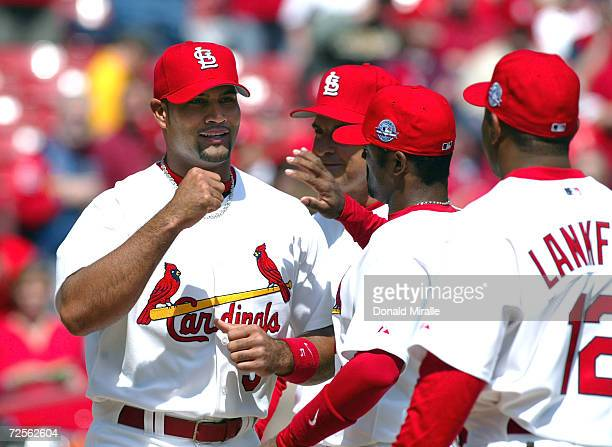 Albert Pujols of the St Louis Cardinals walks onto the field and greet his teammates as he is introduced to the fans before the start of the...