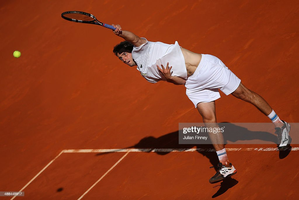 <a gi-track='captionPersonalityLinkClicked' href=/galleries/search?phrase=Albert+Ramos&family=editorial&specificpeople=6878507 ng-click='$event.stopPropagation()'>Albert Ramos</a> of Spain in action against David Ferrer of Spain during day four of the Mutua Madrid Open tennis tournament at the Caja Magica on May 6, 2014 in Madrid, Spain.