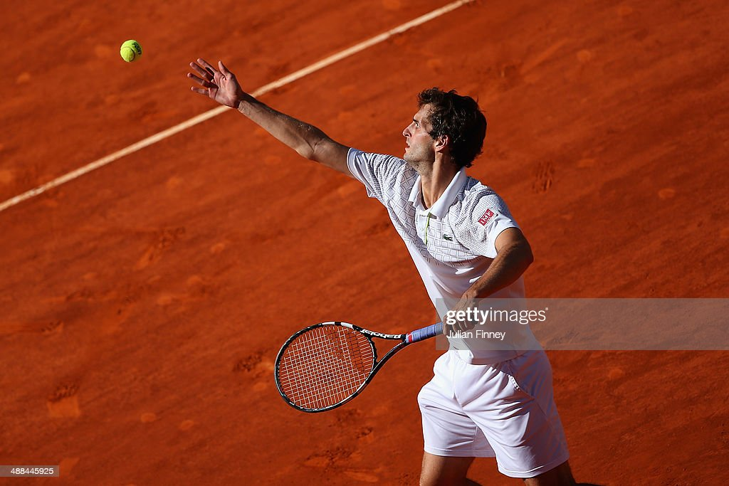 Albert Ramos of Spain in action against David Ferrer of Spain during day four of the Mutua Madrid Open tennis tournament at the Caja Magica on May 6, 2014 in Madrid, Spain.
