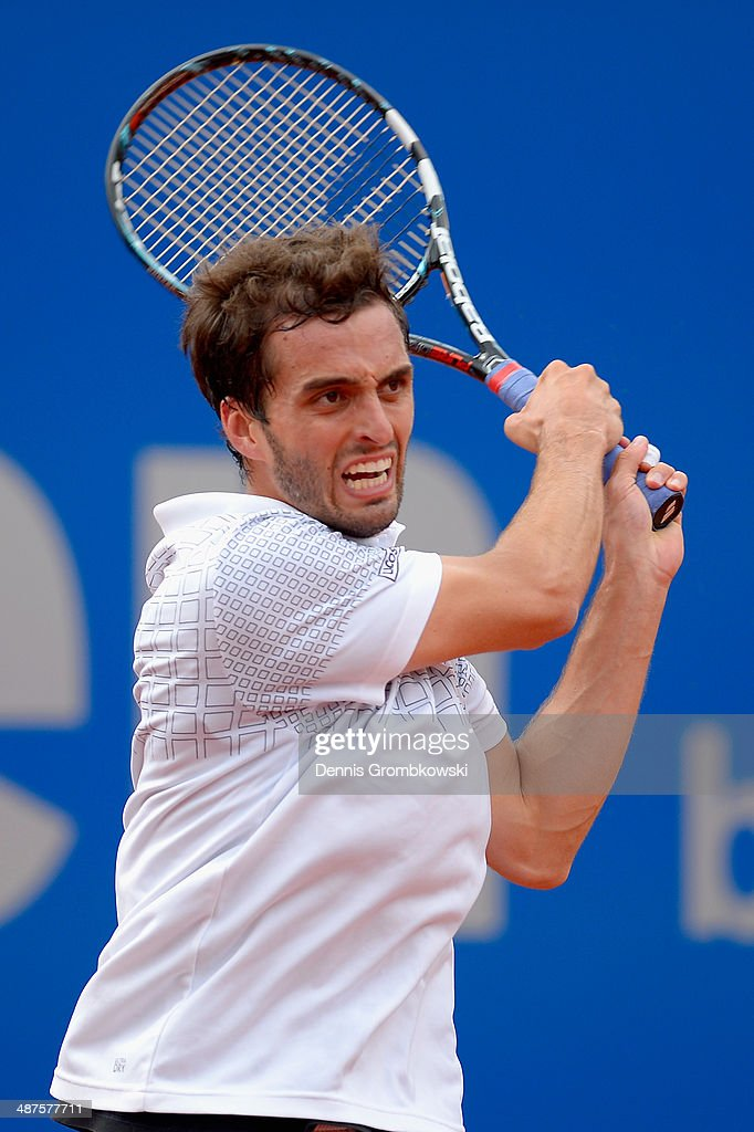 <a gi-track='captionPersonalityLinkClicked' href=/galleries/search?phrase=Albert+Ramos&family=editorial&specificpeople=6878507 ng-click='$event.stopPropagation()'>Albert Ramos</a> of Spain plays a backhand during his match against Andreas Seppi of Italy during the BMW Open on May 1, 2014 in Munich, Germany.