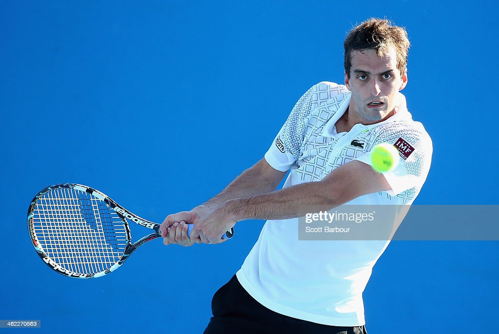 <a gi-track='captionPersonalityLinkClicked' href=/galleries/search?phrase=Albert+Ramos&family=editorial&specificpeople=6878507 ng-click='$event.stopPropagation()'>Albert Ramos</a> of Spain plays a backhand in his first round match against Pablo Andujar of Spain during day one of the 2014 Australian Open at Melbourne Park on January 13, 2014 in Melbourne, Australia.