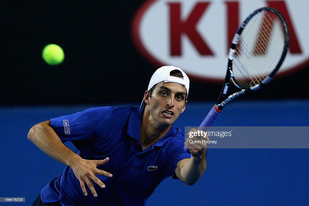 Albert Ramos of Spain plays a forehand in his first round match against Marcos Baghdatis of Cyprus during day one of the 2013 Australian Open at Melbourne Park on January 14, 2013 in Melbourne, Australia.